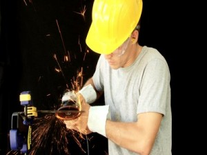 man-using-a-small-angle-grinder